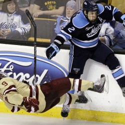 Maine's Mike Cornell checks Boston College's Barry Almeida (9) to the ice in the third period of the Hockey East final in Boston, Saturday, March 17, 2012. Cornell was charged with roughing.