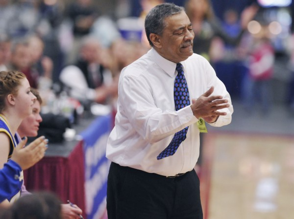 Washburn High School girls basketball coach Michael Carlos reacts as his team plays Richmond High School in the first half of their state Class D championship game in Augusta Saturday, March 3, 2012.