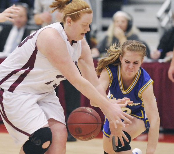 Washburn High School girls basketball player Carmen Bragg (right) scrambles for a loose ball with Richmond player Alyssa Pearson (33) in the first half of their  state Class D championship game in Augusta Saturday, March 3, 2012.