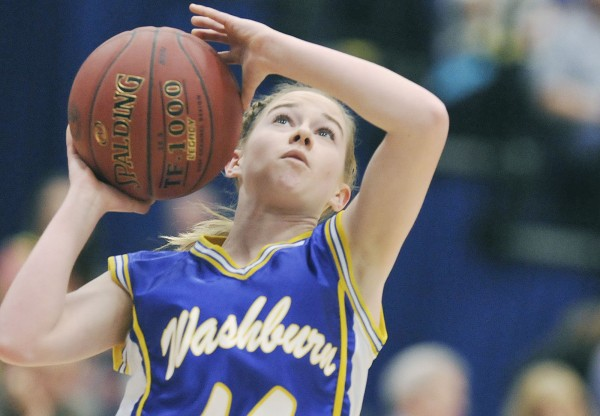 Washburn High School girls basketball player Mackenzie Worcester (14) drives for two points in the first half of their state Class D championship game against Richmond High School in Augusta Saturday, March 3, 2012.