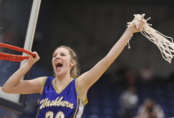 Washburn High School girls basketball player Olivia Doody swings a net, symbolic of the team's championship victory, as her team defeated the Richmond girls in the  state Class D championship game in Augusta Saturday, March 3, 2012.