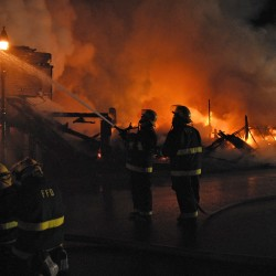 Firefighters from eight departments from Maine and New Brunswick fought a major fire in downtown Fort Kent early Sunday morning.