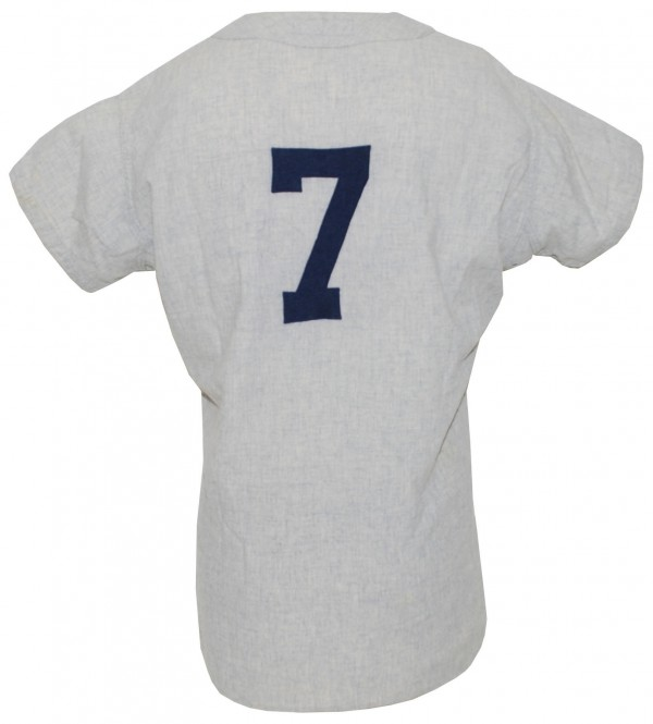 The 1958 Mickey Mantle New York Yankees game-used flannel road jersey brought $114,000 in a recent Grey Flannel auction.