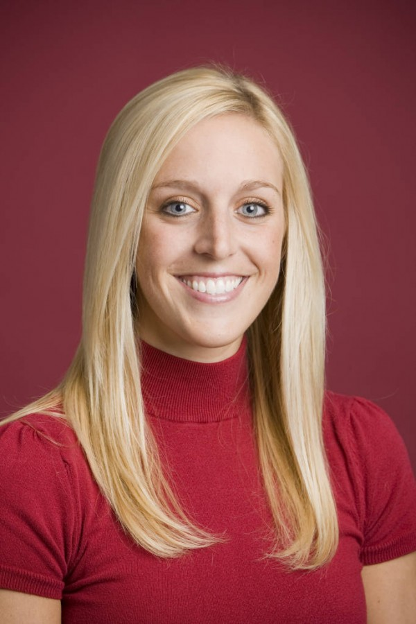 In this undated image released by the University of Arkansas, Razorback Foundation assistant director Jessica Dorrell poses for a photo. Arkansas has fired Bobby Petrino as football coach on Tuesday, saying he engaged in reckless behavior. The 51-year-old Petrino was injured in an April 1 motorcycle accident. He was put on paid leave last week after admitting he lied about the presence of the 25-year-old employee, Dorrell, who had been riding with him.