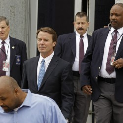 Former presidential candidate and U.S. Sen. John Edwards, center, leaves a  federal court surrounded by US Marshals in Greensboro, N.C., Monday, April 23, 2012.