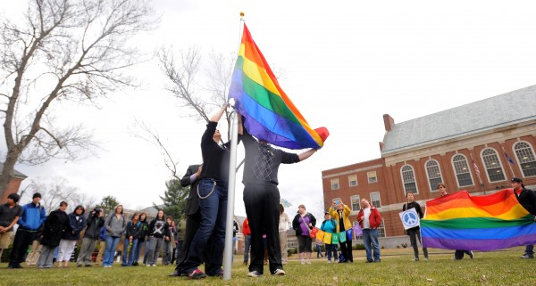 Rebecca Hickman (left) and Evan McDuff raise the Gay Pride flag in the front of the Fogler Library to mark the start of the annual Pride Week at the University of Maine. The events over the coming days are a celebration of gay, lesbian, bisexual and transgendered people.