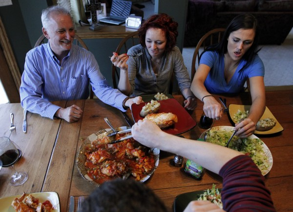 Jeff Sesol, left, with daughters Mary Elizabeth and Amy, serves chicken and salad for dinner in Homer Glen, Illinois, on March 27, 2012. Jeff and Amy both have dietary restrictions due to intolerances for certain foods so the whole family dines to accommodate their diets.