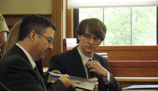 Thayne Ormsby talks to his attorneys during a hearing in Houlton in June.