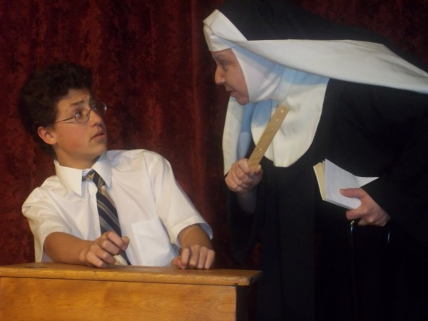 Tom Boss of Orono as Rudy and Irene Dennis of Bangor as Sister Clarissa in the Orono Community Theatre production of Over the Tavern, April 26-29.