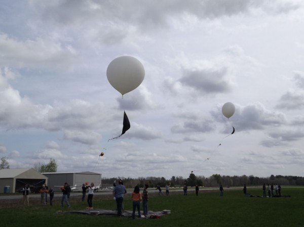 University of Maine High-Altitude Ballooning project students along with several Bangor High School students help launch two balloons at Pittsfield Municipal Airport on Wednesday, April 25, 2012.