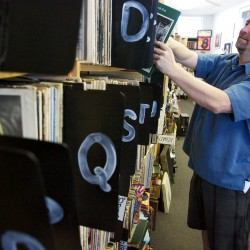 Curt Stephens of Halifax, Nova Scotia, browses the used albums at Vinylhaven Records on Maine Street in Brunswick on Tuesday April 17, 2012. Stephens said he visits Maine often, to see relatives, and always picks up a few more discs at the store.