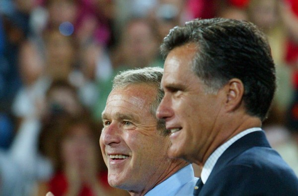 President George W. Bush is introduced by Massachusetts Gov. Mitt Romney at a campaign rally in August 2004.