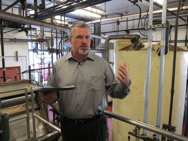 Jeff Shaw, plant manager for the AdvancePierre Foods facility on St. John Street, describes the company's on-site wastewater treatment equipment. The facility was the first stop Thursday morning, May 31, 2012, on a Portland city tour of sites tied to a looming $170 million sewer system overhaul.