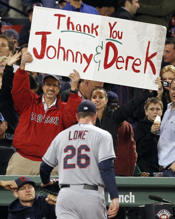 Derek Lowe (26) of the Cleveland Indians walks back to the dugout as fans hold a sign thanking him and teammate Johnny Damon, both former Boston Red Sox players, in the sixth inning of a baseball game against the Red Sox in Boston, Thursday, May 10, 2012.
