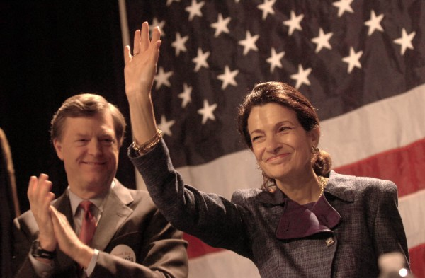 U.S. Sen. Olympia Snowe waves to her supporters after delivering her speech at the Maine GOP Convention Sunday afternoon at the Augusta Civic Center. Behind her is her husband, former Maine Gov. John McKernan.