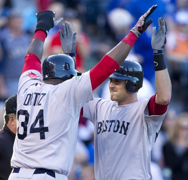 Will Middlebrooks, right, of the Boston Red Sox is congratulated by teammate David Ortiz (34) after hitting a three-run home run against the Kansas City Royals in the first inning on Monday, May 7, 2012, in Kansas City, Missouri.