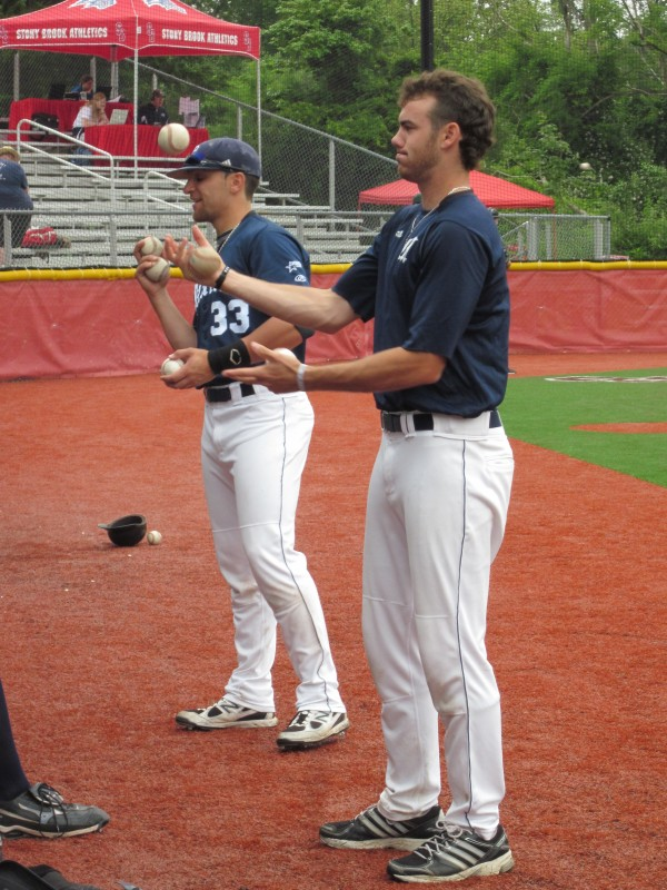 Nick Bernardo (right) and Kyle Silva of the University of Maine try to show off their juggling skills prior to Friday's game against Binghamton at the America East Baseball Championship in Stony Brook, N.Y.