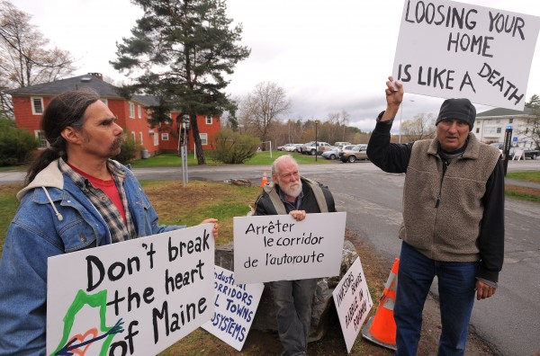 David Bessler of Atkinson (left), Peter Eldredge of Guilford (center) and Peter Brenc of Dover-Foxcroft protest outside the Wells Conference Center on the University of Maine campus in Orono in April 2012. They were protesting outside the Cross-Border Economic Inegration in the Northeast Conference, particularly against the propopesd east-west highway, that would be privately funded and serve to link New Brunswick to Quebec.