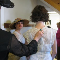Local women modeling vintage fashions Saturday, May 19, 2012 at St. Margaret's Episcopal Church parish hall in Belfast get ready for their turn on the runway. Caseylin Darcy (center) and others are garbed in the clothing of the late 1800s.
