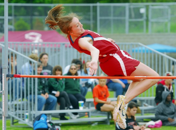 Mary Butler of Bangor clears 4 feet 6 inches in the high jump event at the 2012 PVC Large School Championship Meet in Brewer Friday.