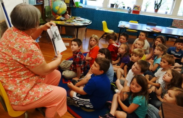 Bonnie Maguire, a reading specialist at the Gladys Weymouth School in Morrill, helps kindergartners think of what they may include in their notes to Capt. Tyler Streit, who is serving in the U.S. Air Force in Afghanistan. Streit attended kindergarten in the same school and classroom nearly 20 years ago.