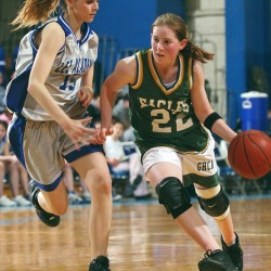 Greater Houlton Christian Academy's, Megan Korhonen brings the ball up the floor against Lee's Karin Bird during an Eastern Maine tourney game in 2005. Korhonen has been named the Central Aroostook girls basketball coach.