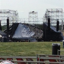This photo provided by Alexandra Mihan shows a collapsed stage at the site for a Radiohead concert at Downsview Park in Toronto on Saturday June 16, 2012. Toronto paramedics say one person is dead and another is seriously hurt after the stage collapsed while setting up for a Radiohead concert.