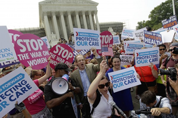 Supporters of President Barack Obama's health care law celebrate outside the Supreme Court in Washington, Thursday, June 28, 2012, after the court's ruling.