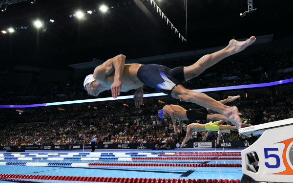 Michael Phelps dives at the start of the men's 200-meter freestyle final at the U.S. Olympic swimming trials on Wednesday, June 27, 2012, in Omaha, Neb. Phelps won the race.