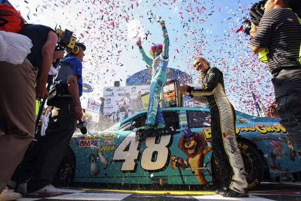 Jimmie Johnson celebrates in victory lane after winning the NASCAR Sprint Cup Series FedEx 400 auto race at Dover International Speedway, Sunday, June 3, 2012, in Dover, Del.