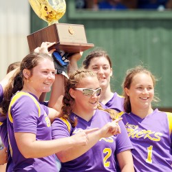 The Bucksport Golden Bucks, Shelby Redman (from left to right), Jennifer Wight, Bailey Blair and Sadie Wight celebrate their 2-0 win over the Dirigo Cougars in the Class C State Softball Championship on Saturday at Saint Joseph's College in Standish.