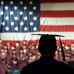 In this Tuesday, May 22, 2012, photo, a graduating student makes his way to the stage during Porterville Adult School Graduation Ceremony at Frank 'Buck' Shaffer Theatre at the Porterville Auditorium in Porterville, Calif.