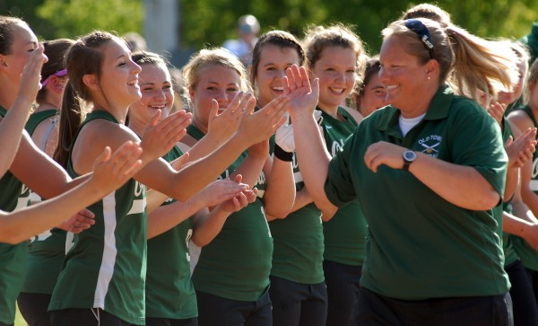 Old Town softball coach Jenn Plourde celebrates with her team after their 4-1 victory over Fryeburg Academy in the Class B state softball final in Brewer on June 16. Plourde has been named the new girls varsity soccer coach at John Bapst High School.