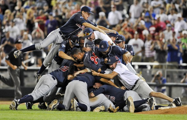 Arizona players pile up following their 4-1 victory over South Carolina in Game 2 to win the NCAA College World Series baseball finals in Omaha, Neb., Monday, June 25, 2012.