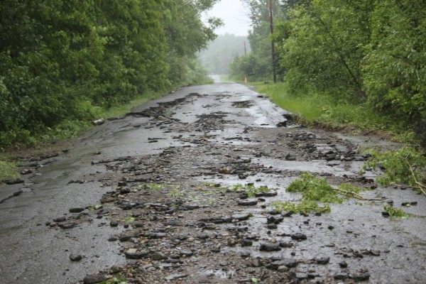 Five days of rain in Aroostook County has damaged roads in several areas, including the Patten area, where 12 inches of rain has fallen as of Wednesday, June 27, 2012. Roads and bridges in Houlton, Bridgewater and Crouseville were flooded or closed Wednesday due to rain.