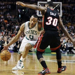 Boston Celtics guard Avery Bradley (0) drives by Miami Heat guard Norris Cole (30) in the second half of an NBA basketball game in Boston, Sunday, April 1, 2012. The Celtics won 91-72.
