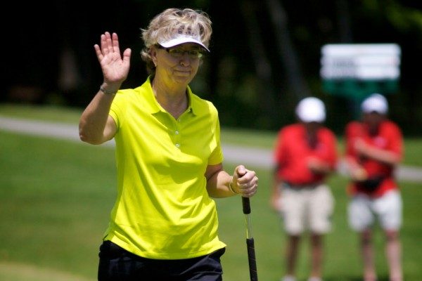 LPGA Legends Tour golfer Sherri Turner acknowledges applause at the Hannaford Community Challenge Tournament in Falmouth Sunday, June 24, 2012. Turner won, coming in six under par.