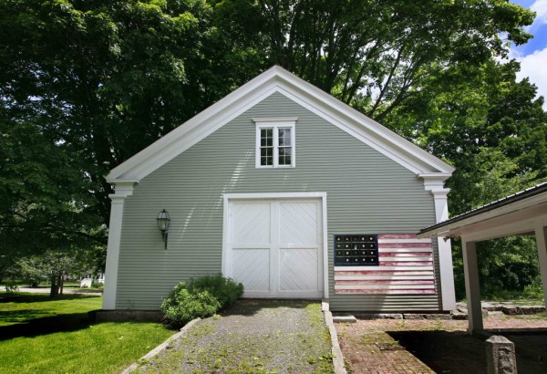 A fading flag decorates a barn near downtown Kennebunk recently.