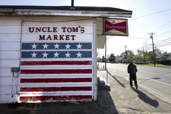 Uncle Tom's Market, a small convenience store on Route 1 in Brunswick, uses an American flag to attract customers recently.