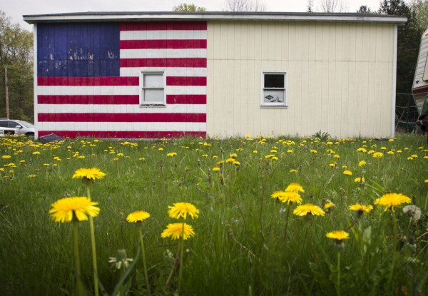 A garage in Randolph is partially painted with a starless vision of the American flag.