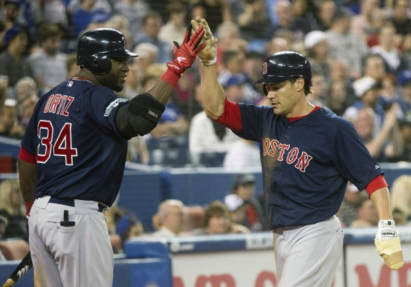 Boston Red Sox's Scott Podsednik (right) celebrates with teammate David Ortiz after scoring a run against the Toronto Blue Jays during eighth-inning action in Toronto on Friday, June 1, 2012.