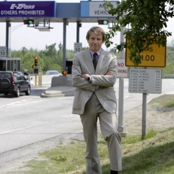 Peter Mills, acting executive director of the Maine Turnpike Authority, stands by a turnpike tollbooth in Portland recently.