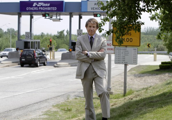Peter Mills, executive director of the Maine Turnpike Authority, stands by a turnpike tollbooth in Portland in June 2011.