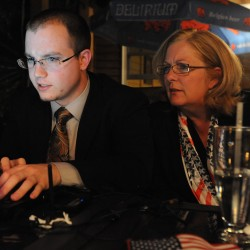 Debra Plowman (right) sits with her volunteer Ben Kelleher at McLaughlin's at the Marina restaurant in Hampden on Tuesday, June 12, 2012 watching election results come in on a laptop.
