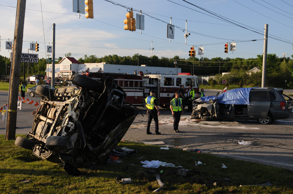 Bangor police investigate a three-vehicle crash on Broadway that took the life of one person on Sunday, June 10, 2012.