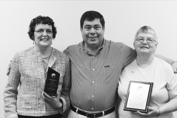 Wayne Melanson, volunteer manager of  Hospice of Eastern Maine (center), congratulates Cheryl Huskins (left), recipient of the Lillian Rivers Award and Jean Trott , recipient of the Patricia James Award for exceptional volunteer service.