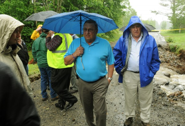 Gov. Paul LePage and state Rep. Paul T. Davis Sr. inspect the washed-out road on Pleasant River Road in Brownville on Tuesday, June 26, 2012. LePage was in town to see the devastation firsthand.