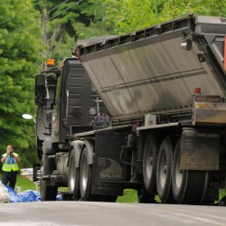 Load of paper rolls shifts, tips 18-wheeler on Odlin Road in Bangor