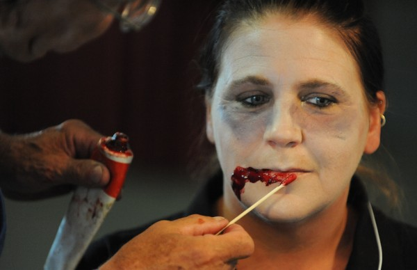Lynn Powers of the Matttawamkeag Fire Department gets made up as a zombie by make up artist Don Wade of Orrington on Thursday, June 21, 2012, during the Zombie Apocalypse 2012 regional tabletop exercise in Bangor. The exercise was intended to help prepare emergency agencies to deal with a pandemic of any type.