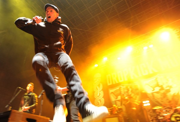 Al Barr, lead singer for Dropkick Murphys, leaps about the stage in 2011 during a concert in Bangor.
